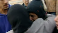 President Assad has no intention of quitting but allows aid to Yarmouk Damascus Women hugging after being reunited and distressed woman crying Vox...