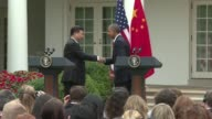 US President Barack Obama and Chinas Xi Jinping vow to fight global warming and halt commercial cyber theft but exchange sharp words on human rights...