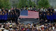 President Barack Obama and his predecessor George W Bush hung their heads at Ground Zero in New York Sunday in silent remembrance of the nearly 3000...