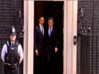 President Barack Obama and Prime Minister Gordon Brown exit 10 Downing street and head for G20 Summit talks 1 April 2009