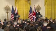 US President Barack Obama arrives in East Room of White House for joint press conference with British Prime Minister David Cameron Clip runs through...
