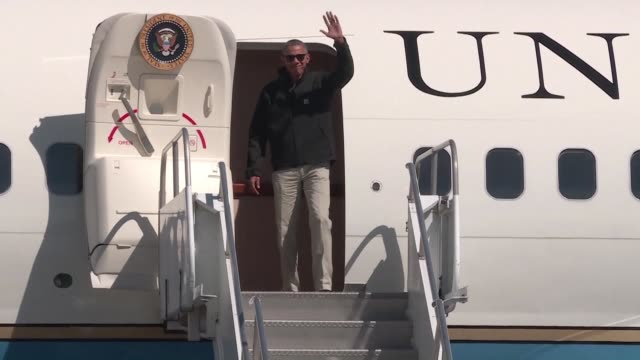 President Barack Obama lands in the Andean resort town of Bariloche for a few hours leisure time after paying homage to victims of Argentinas former...