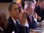 President Barack Obama sits with fellow leaders of G8 around large table as talks commence Italy 10 July 2009