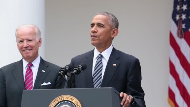US President Barack Obama speaks as US Vice President Joe Biden stands in the Rose Garden at the White House in Washington DC US on Wednesday Nov 9...