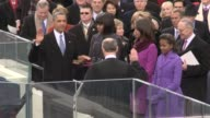 / President Barack Obama takes the oath of Office and is sworn in by Chief Justic John Roberts US Presidential Election 2013 at US Capitol steps on...
