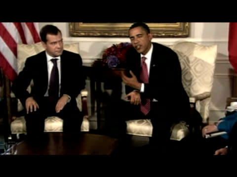 President Barack Obama urges nations holding nuclear weapons to start reducing their stockpiles during press meeting with President Dmitry Medvedev...