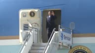 US President Barack Obama walks down stairs off Air Force One walks over to helicopter Marine 1 Air Force One is Boeing 747 Marine 1 helicopter is a...