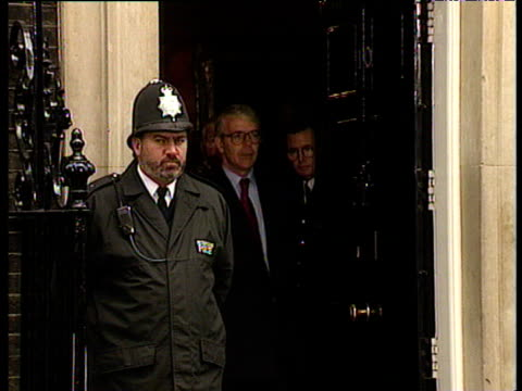 President Bill Clinton and Prime Minister John Major walk out of Number 10 Downing Street to talk to press 29 Nov 95