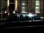 President Bill Clinton's limousine pulls up outside 10 Downing Street Clinton and wife Hillary get out and greet Prime Minister Tony Blair and wife...