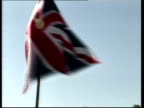 Security demands LIB USA Maryland Camp David Tony Blair MP George W Bush along from helicopter Union Jack flag flying as Blair Bush speak to press...