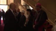 President Donald Trump is welcomed by priest rabbi imam and officials alongside Palestinian President Mahmoud Abbas with an official ceremony at the...