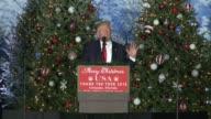 US president Donald Trump thank you tour speech in Orlando Florida many christmas trees as backdrop