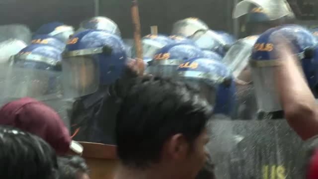 President Duterte serenades Donald Trump Manila EXT Various of antiTrump demonstrators in street sprayed with water cannon Various of riot police...