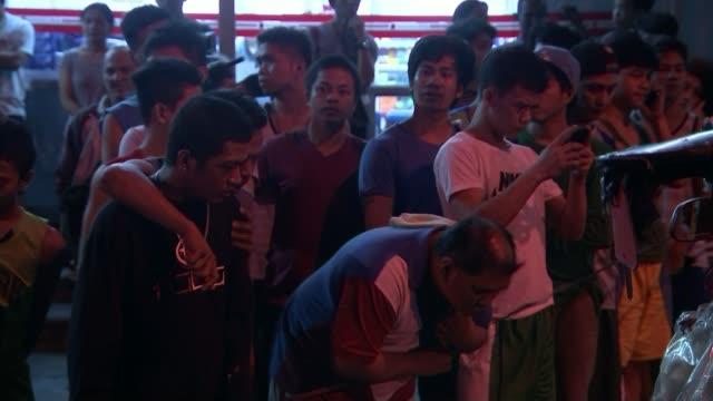 President Duterte serenades Donald Trump T15121610 / Manila Flashing blue police light Men behind line at crime scene POV behind photographer Luis...