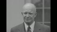 US President Dwight Eisenhower walks down White House steps waits to film statement regarding retirement of British Prime Minister Winston Churchill...
