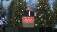 US president elect donald trump speech thank you tour Orlando Florida many christmas trees as backdrop