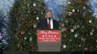 US President Elect donald trump thank you speech in Orlando Florida many christmas trees as backdrop