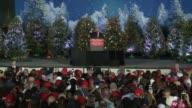 US president elect Donald Trump thank you tour speech in Orlando Florida many christmas trees as backdrop