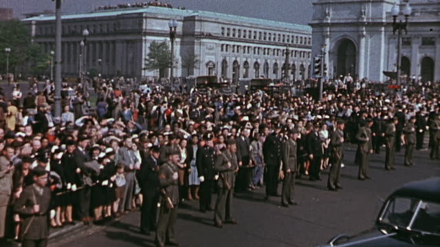 President Franklin D Roosevelt's funeral procession leaving Union Station crowd lining the street and President Truman's Irish Setter Mike waiting in...