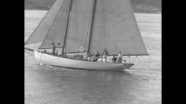US President Franklin D Roosevelt's schooner at sea off coast of Massachusetts / closer view boat with crew / cabin interior featuring probably bunk...