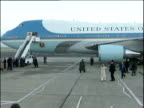 President George W Bush and wife Laura board Air Force One plane takes off Nov 03