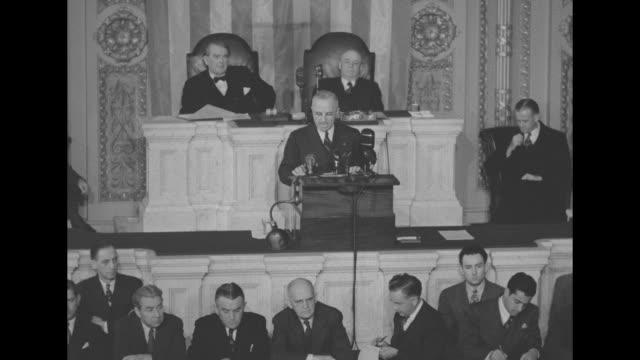 President Harry S Truman entering US House of Representatives chamber Senators and Representatives giving standing ovation / Truman leaving House...