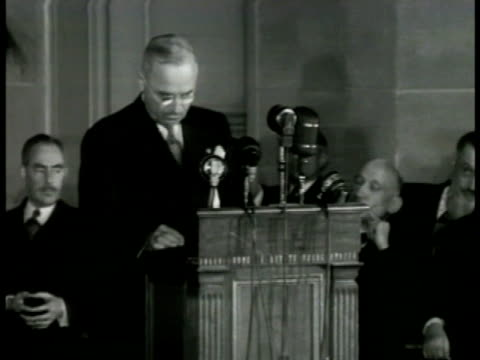President Harry S Truman speaking at podium 'nations joined by democracy individual liberty rule of law pact giving recognition' NATO North Atlantic...