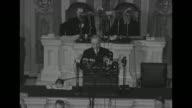 President Harry S Truman speaking with President of Senate Sen Kenneth McKellar and Speaker of the House Sam Rayburn at rostrum behind him