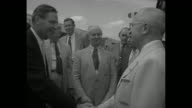 CU President Harry Truman cheerfully talking / President's plane The Independence slowly moving on ground / President at plane door starts down...