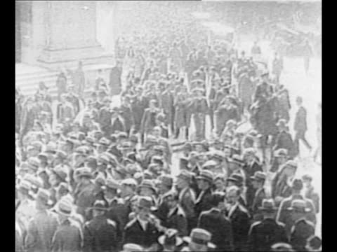 US President Herbert Hoover speaks / montage crowds of people on streets during the Great Depression includes POV from inside building through...