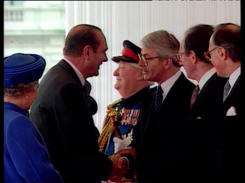 President Jacques Chirac shakes hands and chats with Prime Minister John Major as Queen Elizabeth II looks on Horseguards Parade London 14 May 96