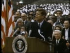 President John F Kennedy speaking at Rice University and audience cheering / Houston Texas United States