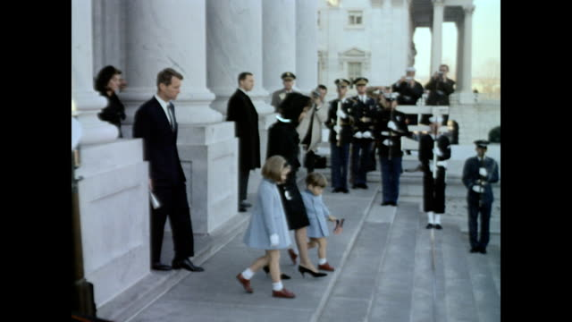 President John F Kennedy's body lies in state / Jackie Kennedy and children Caroline and John Jr Attorney General Robert F Kennedy and members of the...