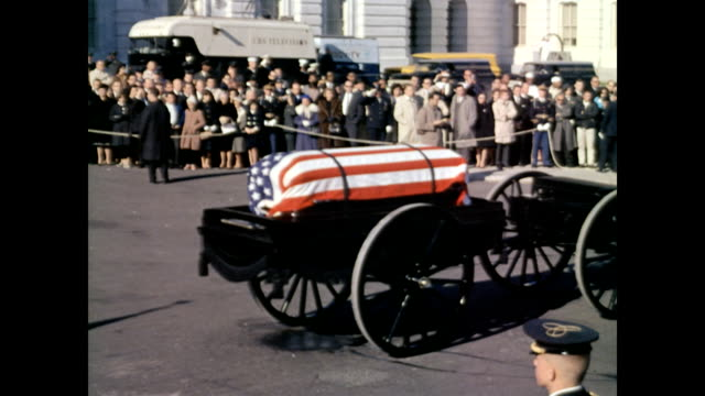 President John F Kennedy's funeral procession / Joint Chiefs of Staff Color Guard two clergymen followed by horsedrawn caisson leaving Capitol /...