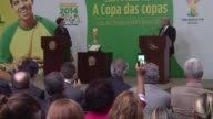 President Joseph Blatter officially presents Brazilian President Dilma Rousseff with the World Cup trophy in Brasilia's Planalto Presidential Palace
