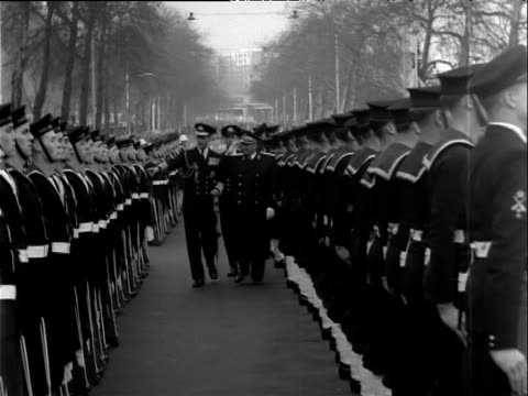 President Josip Tito salutes as he inspects troops with Duke of Edinburgh on bank of River Thames London 16 Mar 53