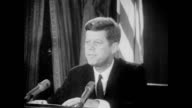 President Kennedy speaks to the nation to inform Americans of recently discovered Soviet military buildup in Cuba including the ongoing installation...