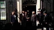 10 Downing Street ENGLAND London 10 Downing Street MS People behind railings at No 10 MS As Makarios Wilson out shake Wilson points to Cypriot...