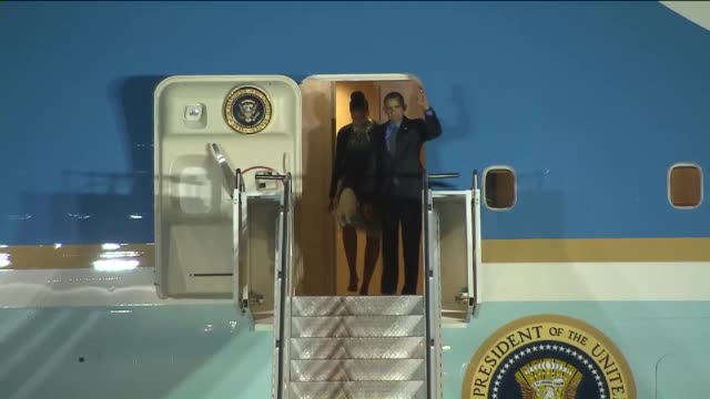 KTLA President Obama and Michelle Obama Arrive at San Bernardino International Airport to visit with with family members of those killed in the...