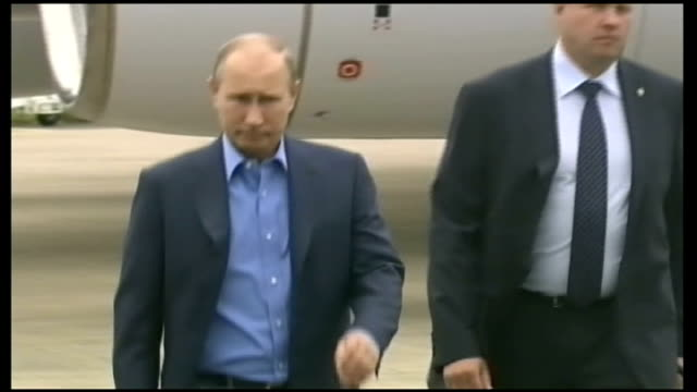President Obama cancels Russian Summit over Edward Snowden LIB Belfast EXT Putin walking across tarmac from plane