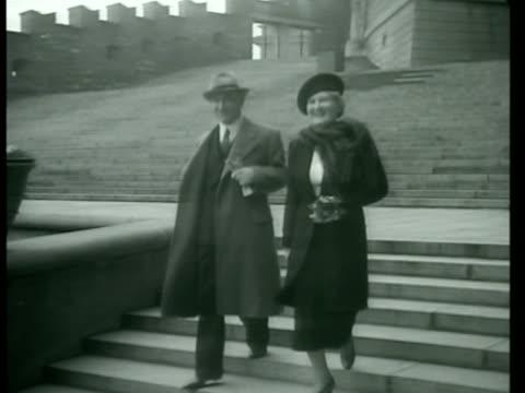 PRAGUE CZECHOSLOVAKIA President of Czechoslovakia Edvard Benes walking down steps w/ wife Hana Benesova both smiling