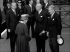 President of Finland departs and is bid farewell by Heath and Macmillan ENGLAND London Victoria INT Urho Kekkonen handshake at train station with...