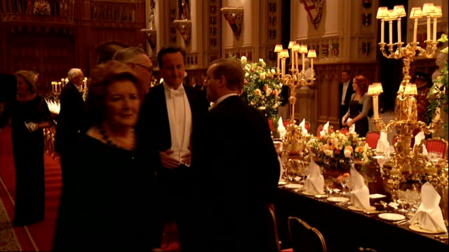 State banquet ENGLAND Berkshire Windsor Castle INT General views Banqueting room as guests begin to arrive and music plays in background SOT / David...