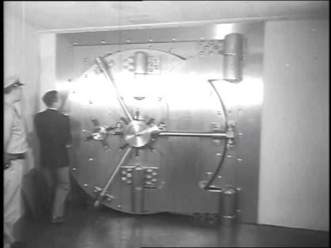 President of Iron Mountain Atomic Storage vaults Herman Knaust opening 30ton door guarding main passage to 400 vaults in underground storage...
