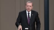 President of Turkey Recep Tayyip Erdogan holds a press conference ahead of his visit to Kazakhstan at the Esenboga Airport in Ankara Turkey on April...