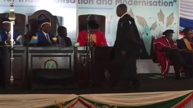 President Robert Mugabe attends a university graduation ceremony making his first public appearance since military generals took control of Zimbabwe...