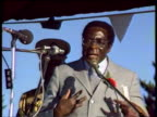 President Robert Mugabe on stage at political rally 1980s