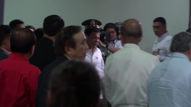 President Rodrigo Duterte press conference PHILIPPINES Manila INT **Music overlaid SOT** Rodrigo Duterte arriving at press conference and speaking at...
