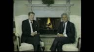 President Ronald Reagan and Prime Minister Bob Hawke sits on chairs in front of fire place photo call / Reagan 'ANZUS is very much alive' / Reagan...