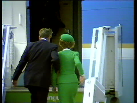 President Ronald Reagan and wife Nancy walk up plane steps and turn and wave as they leave Ireland 04 Jun 84